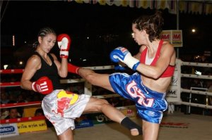 Theresa and I fighting for the WPMF 126lb title, King's Birthday, 2009. Photo by Rob Cox.